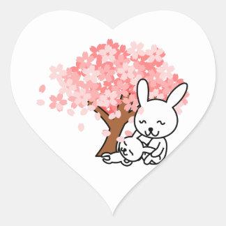 Happy Bunny Rabbits Under a Cherry Tree Heart Sticker