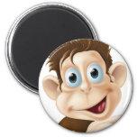 Happy cartoon monkey pointing magnet