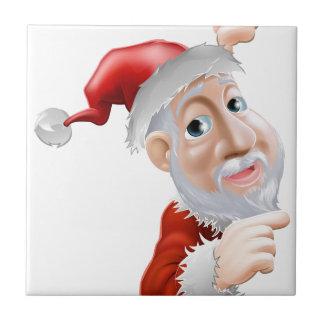 Happy cartoon Santa pointing to side Ceramic Tiles