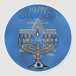 """Happy Chanukah - Menora & Star of David Classic Round Sticker<br><div class=""""desc"""">The lighting of the candelabra, known as the Hanukiyah or the Menorah, is one of the traditions and practices surrounding the celebration of Hanukkah. Jewish symbols celebrate the Hanukkah season in this design, with the words """"Happy Chanukah"""" - """"Festival of Lights"""". The blue Star of David refers to the the...</div>"""