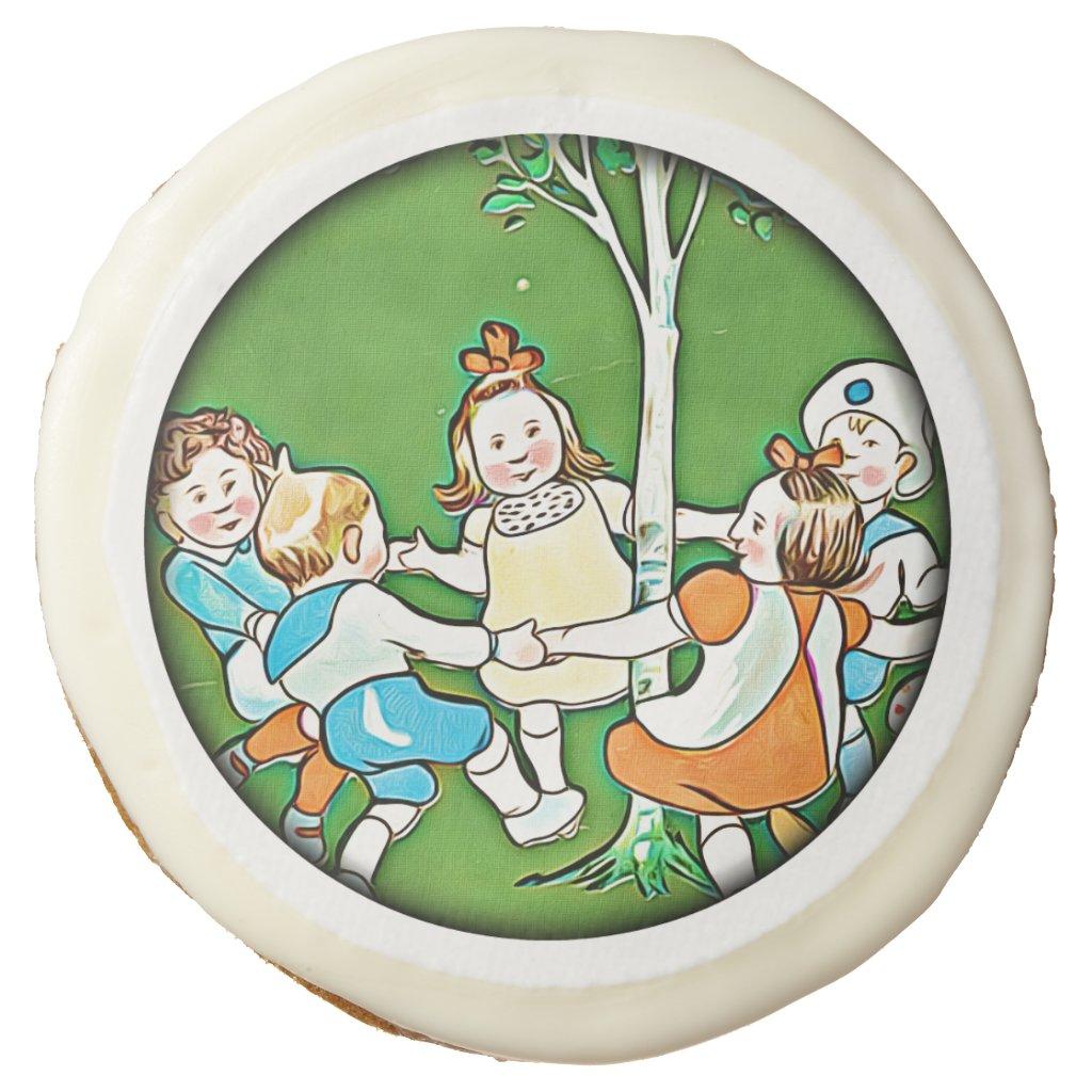 Happy children dancing round the tree kids cookies