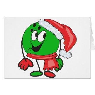 Happy christmas bowling ball wearing a santa cap greeting card