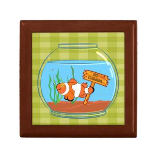 Happy clown fish sleeping in a fish bowl jewelry box