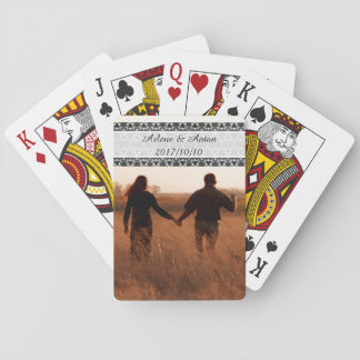 Happy couple strolling playing cards