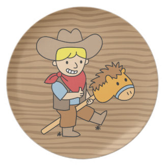 Happy cowboy riding on a horse stick plate