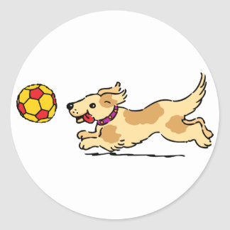 Happy dog playing with a ball sticker