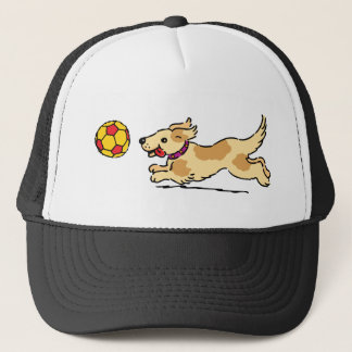 Happy dog playing with a ball trucker hat