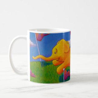 Happy flying yellow elephant wins the race fun art coffee mug