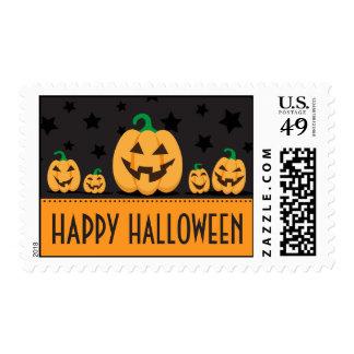 Happy Halloween postage stamps with pumpkins