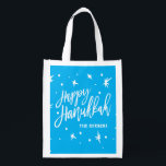 "Happy Hanukkah Brush Script Custom Name Grocery Bag<br><div class=""desc"">A great gift for your favorite family or fun for your own home for Hanukkah. Celebrate the Festival of Lights with this reusable bag,  personalized with your name. Need help with customization? Email us at hello@christiekelly.com for complimentary assistance.</div>"