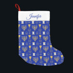 "Happy Hanukkah Jewish Holiday Small Christmas Stocking<br><div class=""desc"">An elegant Happy Hanukkah pattern of Jewish symbols of menorah,  star of David, scroll,  in gold on a dark blue background stockings. A stylish gift for Jews friends and family this holiday season. Customize and personalize the name.</div>"