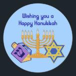 "Happy Hanukkah Sticker<br><div class=""desc"">""Wishing you a Happy Hanukkah"". Stickers with a dreidle,  menorah & star of david in bright colors.</div>"