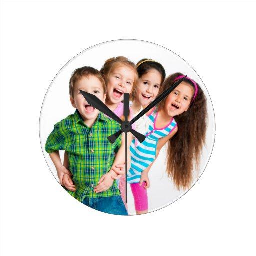 Happy kids spreading joy round wall clock