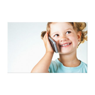 Happy Little Girl Speaking By Cell Phone Stretched Canvas Prints