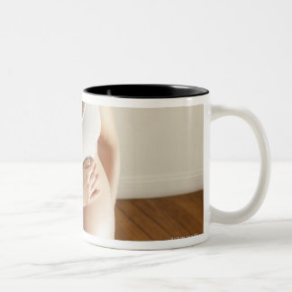 Happy pregnant woman standing on scale Two-Tone coffee mug