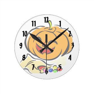 happy pumpkin bag of candy halloween round clocks