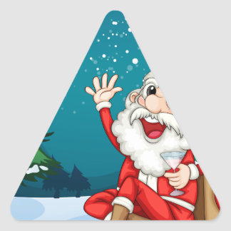 Happy Santa sitting in front of the pine tree Triangle Sticker