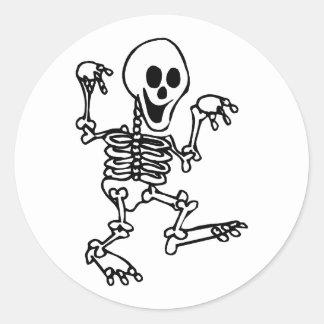 happy skeleton walking hands up halloween classic round sticker