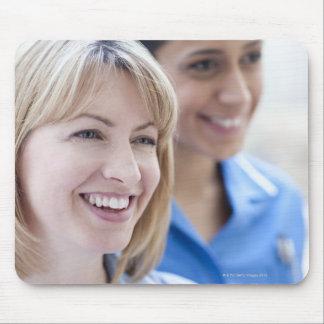 Happy smiling nurses. mouse pad