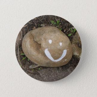 Happy stone button