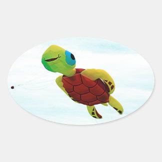 Happy turtle kite flying oval sticker
