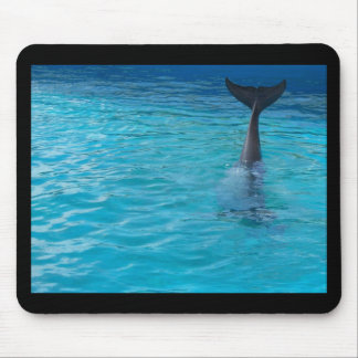 Happy wholphin tail wave mouse pad