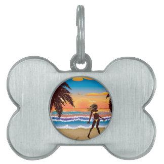 Happy woman on beach pet tag