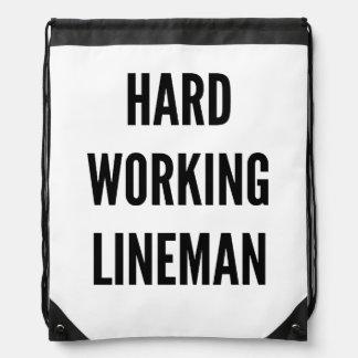 Hard Working Lineman Drawstring Bags