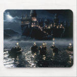 "Harry Potter Castle | Arrival at Hogwarts Mouse Pad<br><div class=""desc"">A film image print from The Sorcerer&#39;s Stone. Harry Potter seen here on his arrival to Hogwarts Castle about to embark on his magical education in witchcraft and wizardry. A moonlight boat ride across the great lake to begin the sorting hat ceremony. This Philosopher&#39;s Stone reference will really stand out...</div>"