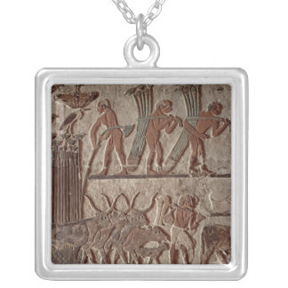Harvesting papyrus and a group of cows silver plated necklace