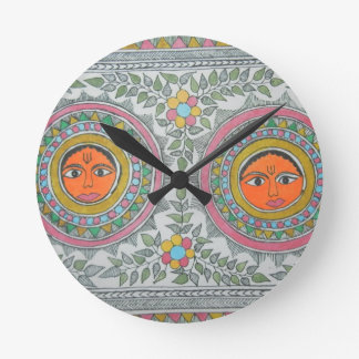 "has a ""sun"" motif in ""madhubani painting"" style. round clock"