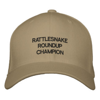 Hat with RATTLESNAKE ROUNDUP CHAMPION on it. Embroidered Baseball Caps