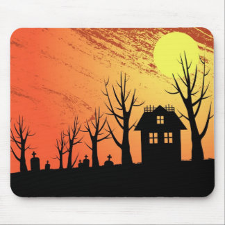 Haunted house and graveyard landscape mouse pad