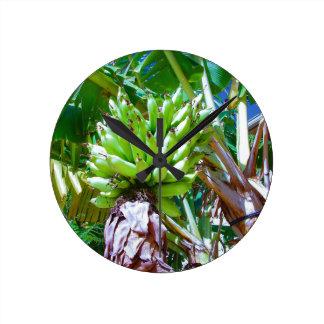 """Hawaii Bannana Tree"" by Carter L. Shepard"" Round Clock"