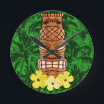 "Hawaiian Tiki Mask Round Clock<br><div class=""desc"">Hawaiian Tiki Mask with yellow hibiscus flowers at it&#39;s base,  the state flower of Hawaii with a background of palm trees.</div>"