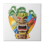 """Hawaiian Tiki Surfing Ceramic Tile<br><div class=""""desc"""">If you love surfing in Hawaii then this gift is for you. A cute Hawaiian tiki statue with classic surfboards. From surfing the North Shore to the Honolulu bay,  get this souvenir for any Hawaiian vacation.</div>"""