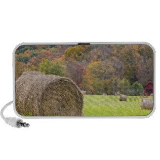 Hay bales and fall foliage on farm, mini speakers