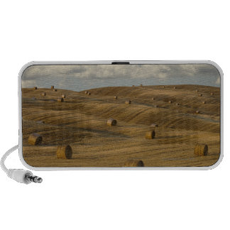Hay bales and rolling landscape, Tuscany, Italy Portable Speakers