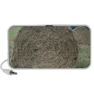 Hay bales in a field under the sky travel speakers