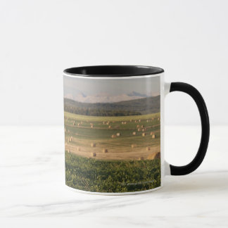 Hay Bales In A Field With Mountains At Sunrise Mug
