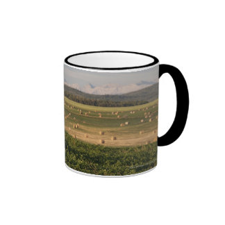 Hay Bales In A Field With Mountains At Sunrise Ringer Mug