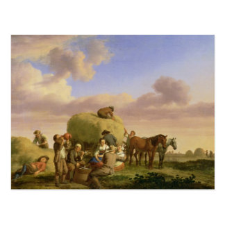 Haymakers resting in a field postcard