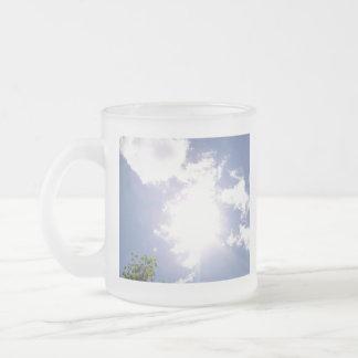 Haz de Sun y taza de las nubes