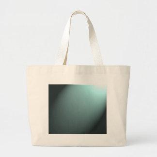 Haz luminoso en azules turquesas profundas bolsas lienzo