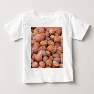 hazelnuts background baby T-Shirt