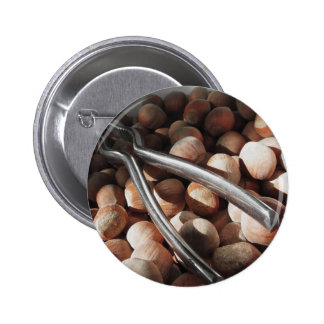 Hazelnuts in bowl with metal nutcracker pinback button