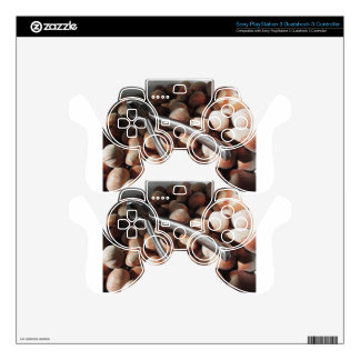 Hazelnuts in bowl with metal nutcracker PS3 controller skins