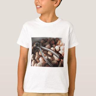 Hazelnuts in bowl with metal nutcracker T-Shirt