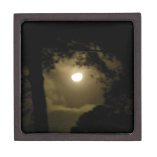 Hazy moon peers through the trees premium keepsake box