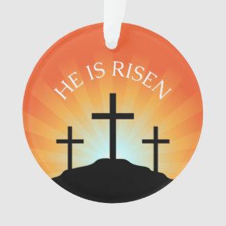 He is risen cross against sunrise Easter